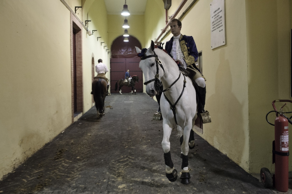 Lisbon. Campo Pequeno. Bullfighters horseman warm up their horses before the show in a private part of the arena