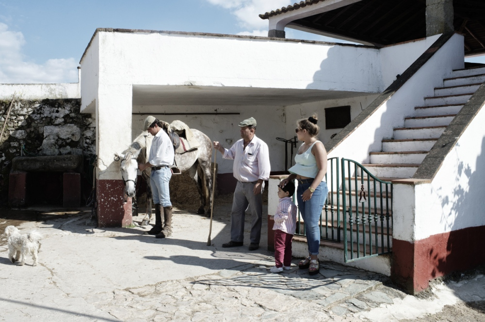 Montemor. Herdade do Perdigão. The family of a farmer wait for the owner of the Herdade that is coming to follow the procedures necessary to transport wild bulls from the Herdade to the bullfight arena.