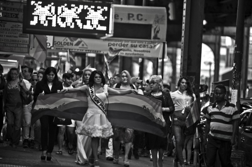 Guiselle Vaquero with a pride flag in public march of the LGTB community resident in Jackson Heights Queens against the events in Orlando where 49 members of the community die into a local club.