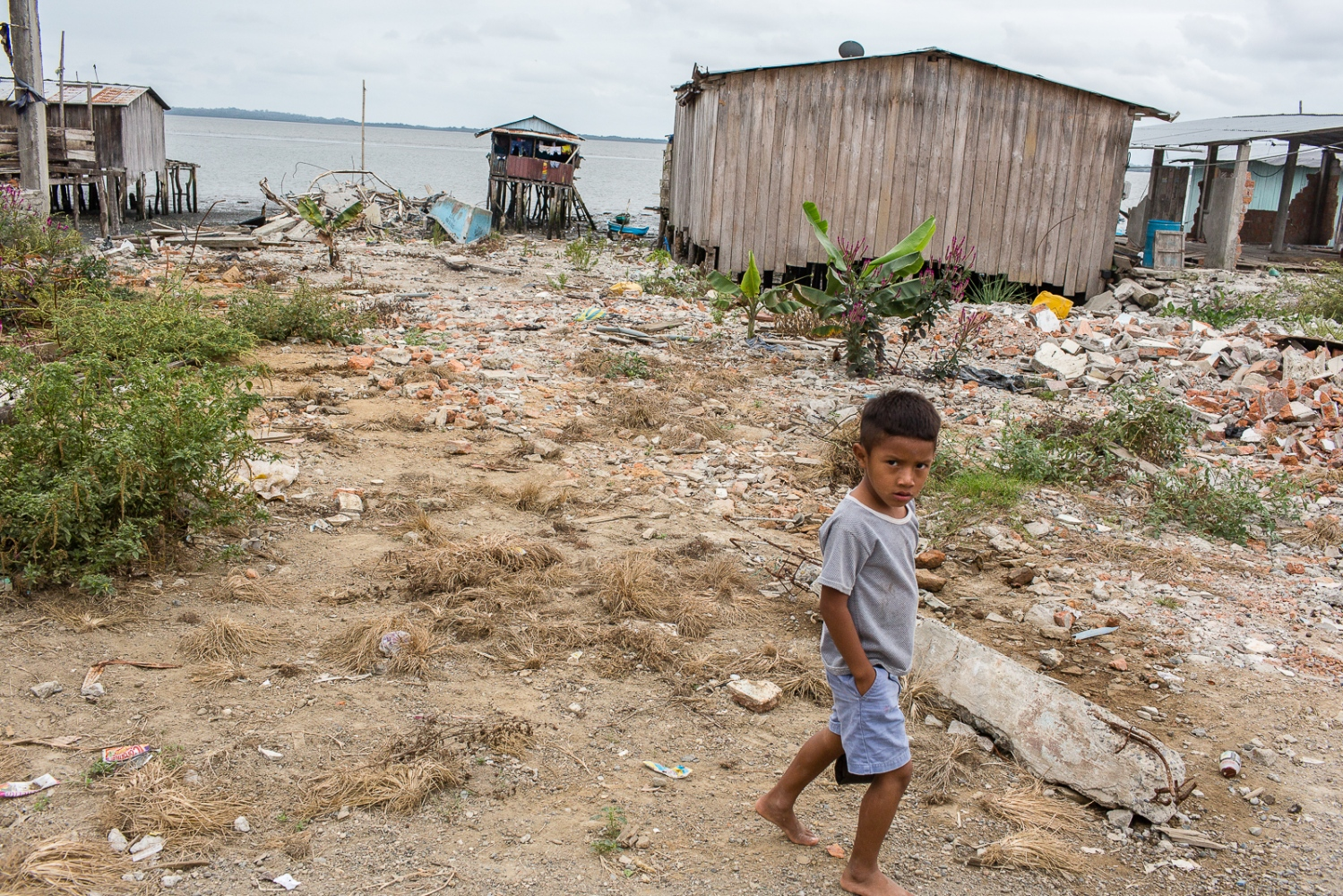 A boy passes in front of place where before many families lived on the coast of Chamanga. The Ecuadorian Government doesn't want to rebuild houses on the coast of Chamanga since it is consider a high-risk area, something that the locals deny. The earthquake reached the magnitude of 7.8 on the Richter scale hit the Ecuadorian coast, where more than a million and half of people live, circa 10% of the total population of the country. On the aftermath, 4,859 were injured and 671 died, mostly because of the collapse of buildings. The areas affected are in a vulnerable socio-economic position, with levels of extreme poverty in some cases, which contributed to the high number of injured and perish people.