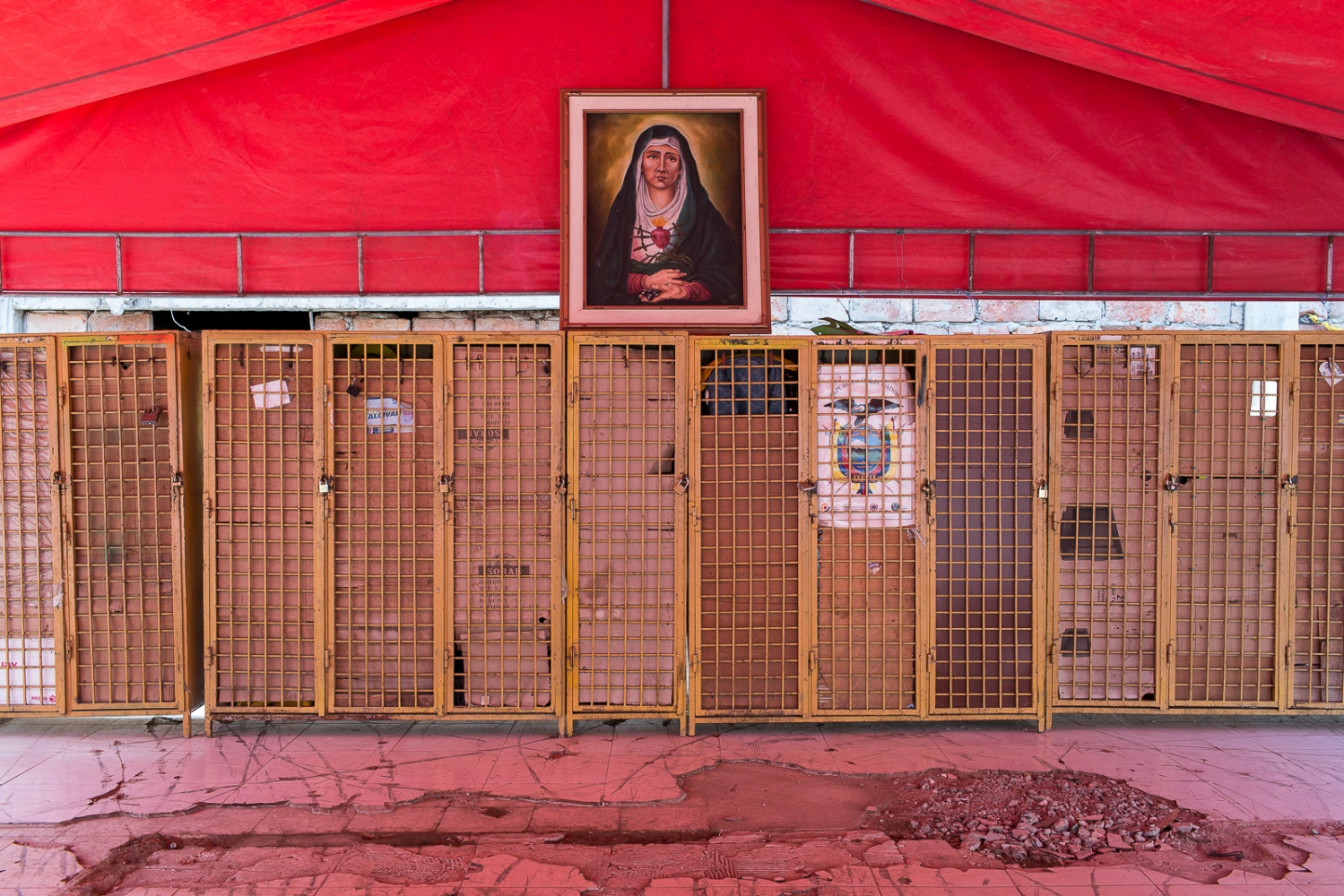 The locker room on the fireman headquarters in Portoviejo, with a portrait of the Lady of the Sorrows. The fireman headquarters collapsed during the 16th April earthquake and they now operate under tents until a new headquarters is build.