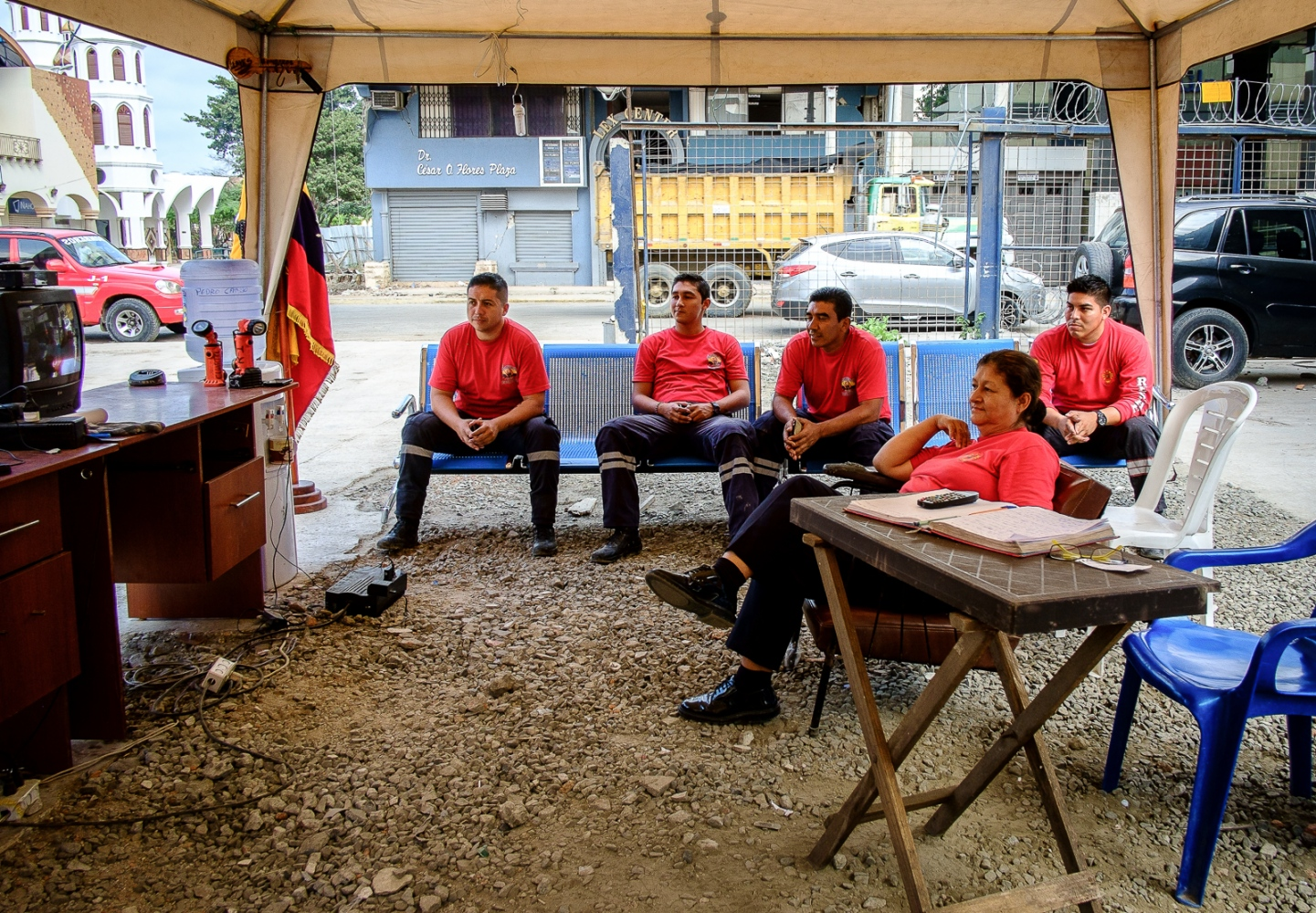 Firemen relax by watching television during their free time in Portoviejo. The fireman headquarters collapsed during the 16th April earthquake and they now operate under tents until a new headquarters is build.