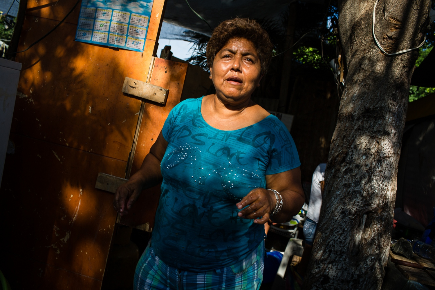 Narcisa Mera, 53, leaving her improvised kitchen in  Sucre Park, the central square in Bahia de Caráquez. Narcisa refuses to move to a shelter provided by the Government, because she is afraid that thieves can steal the few belongings she possesses. She claims that shelters are filled with some bad people and she can't protect her things and her grandchildren. Instead, she prefers to live in the Park in front of her former house that was destroyed by the 16th April earthquake with another 30 families.