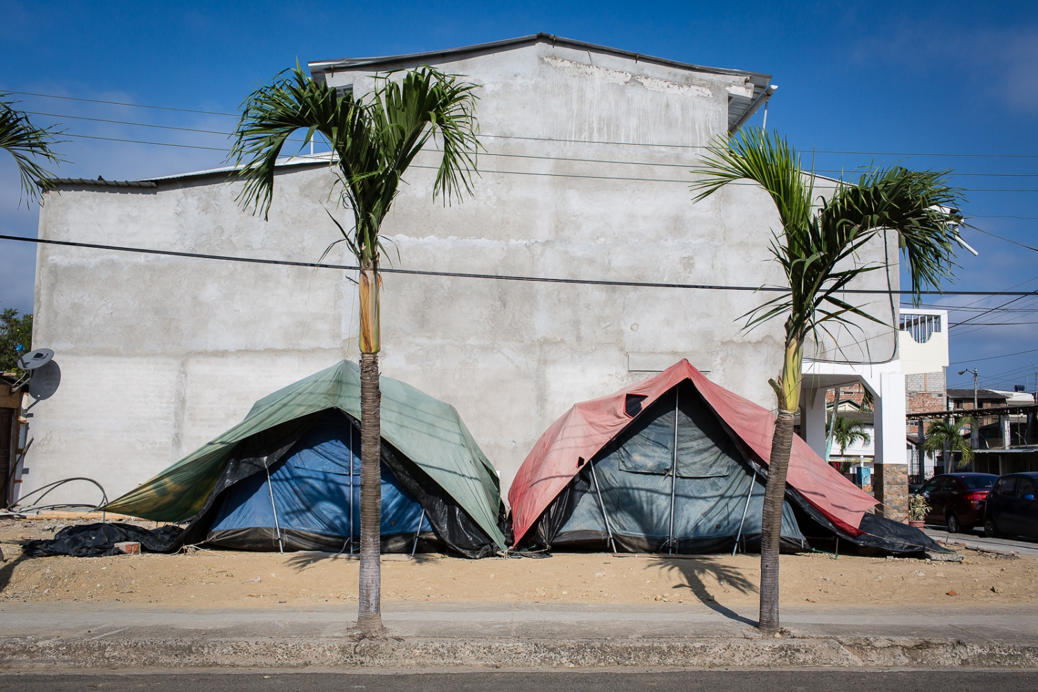 Two makeshift tents on the side walk in Bahia de Caráquez. Bahia is a beach touristic destination, specially to Ecuadorians from the mountains, but after the 16th April earthquake most of the city was damaged and destroyed leaving many locals living in provisional homes all around the city.