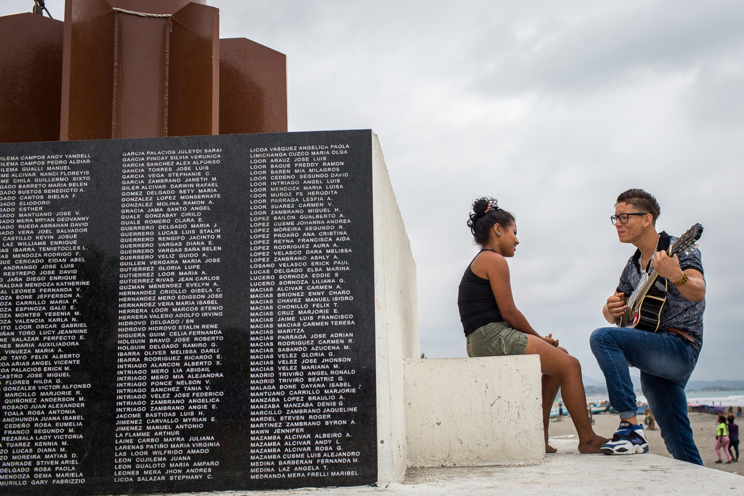 A boy plays a serenade to a girl on the memorial to the victims of the 16th April earthquake in Pedernales. Pedernales was the epicentre of the earthquake, which destroyed much of the city and killed 188 people.