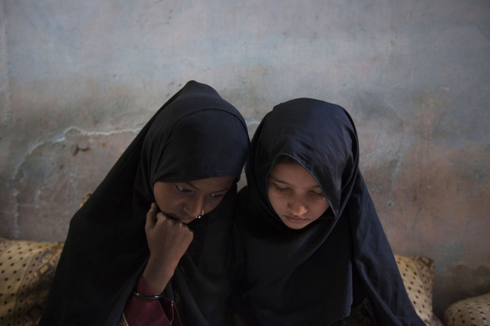 Two young Sheedi girls study in an after-school class set up in a sheedi populated community of Karachi. Karachi, Pakistan
