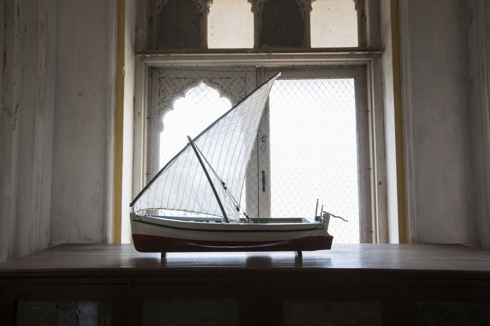The model of a dhow boat built by a member of the sidi Royal family of Janjira and sitting proudly inside Janjira Palace, home of the Nawab of Janjira. Boats exactly like this one were used to bring slaves by the Arab traders from the slave markets of East Africa to the India subcontinent. Janjira, India