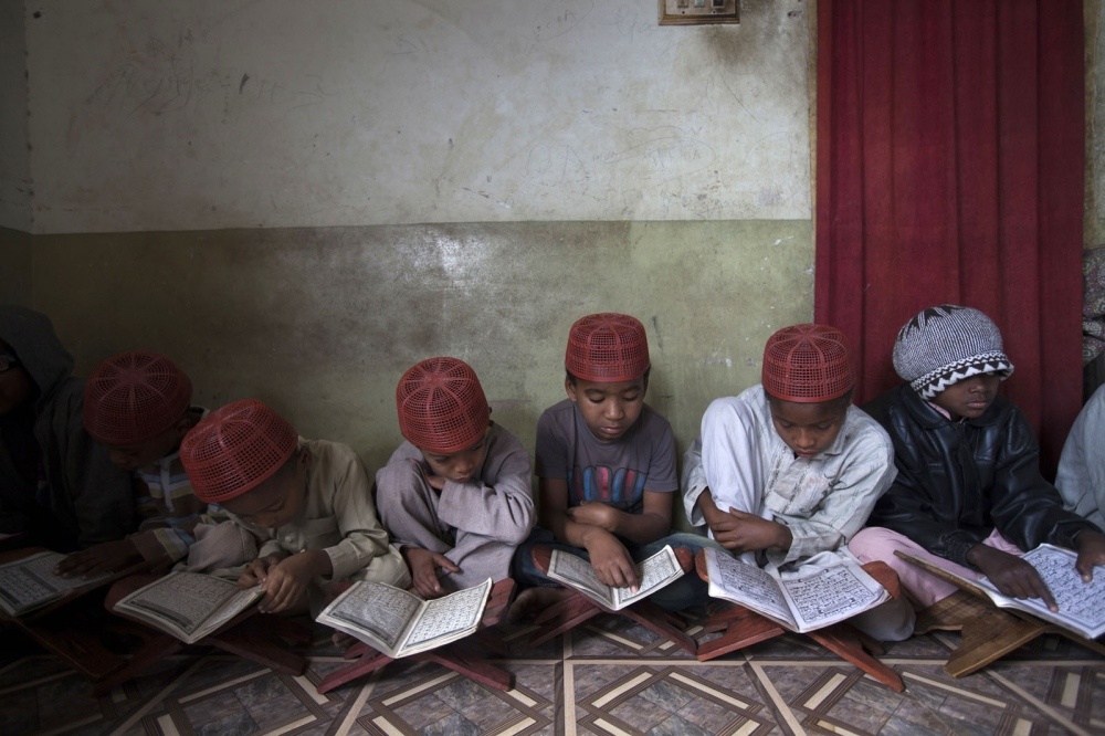 Sheedi boys learn from the Quran in a small madrassa in a rundown suburb of Hyderabad. Hyderabad, Pakistan