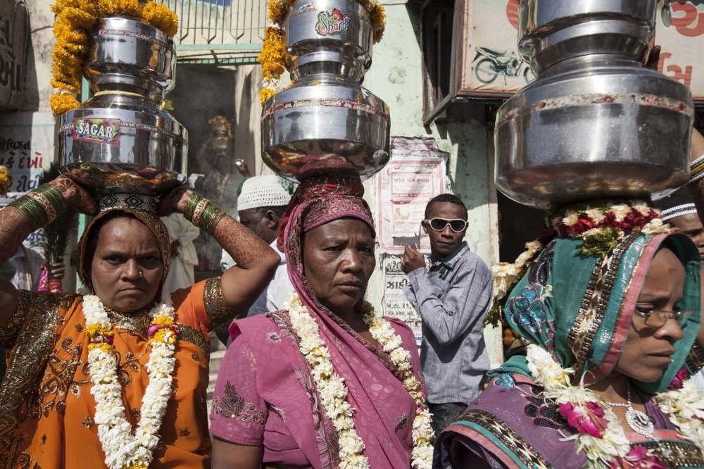 During the annual celebration of Urs, the anniversary of their saint Bava Gor, a procession of Sidi people takes them through the town of Jamnagar to collect Holy water from a sacred shrine before returning to the mosque that they left from. Jamnagar, India