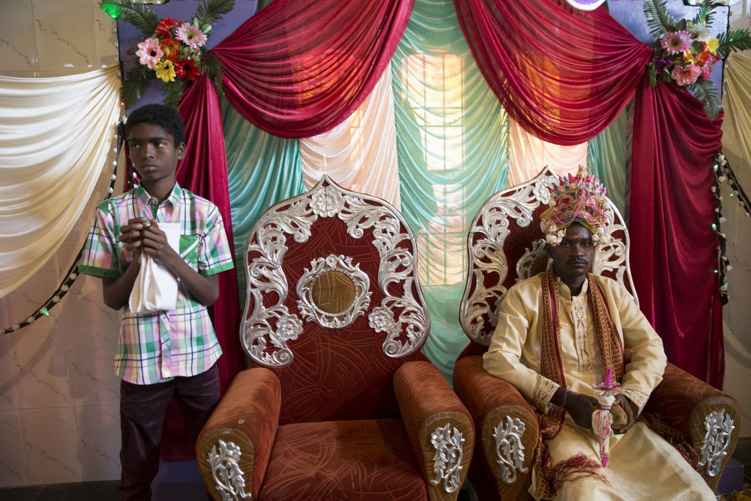 The Sidi groom sits patiently following the instructions by Brahmin priests during this Hindu wedding ceremony in Idgundi village. The first wedding of 2015 in this area receives many guests who come from Sidi villages all around. Uttara Kannada, India