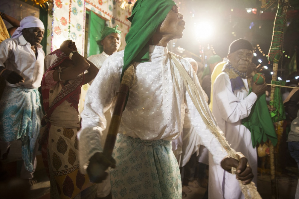 During the annual celebration of Urs, the anniversary of their saint Bava Gor, the Sidi play music, sing and dance all night until morning. Many people become 'possessed' during this ritual and must be controlled by others. Bedi, India