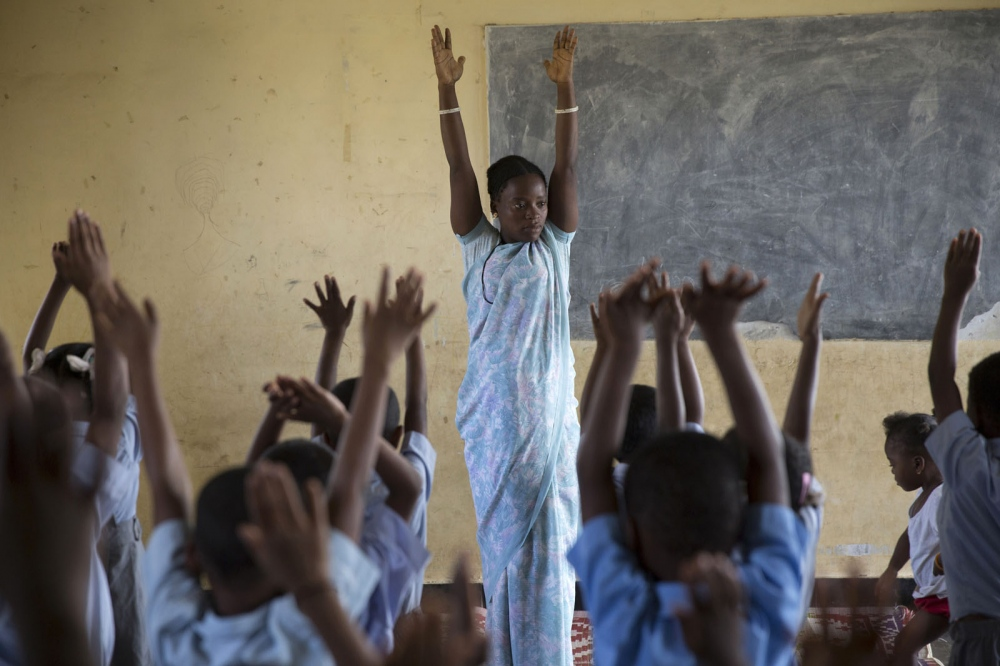 Teacher Jesintha Sidi leads morning stretching exercises at a small rural boarding school at the beginning of the school day. Uttara Kannada, India