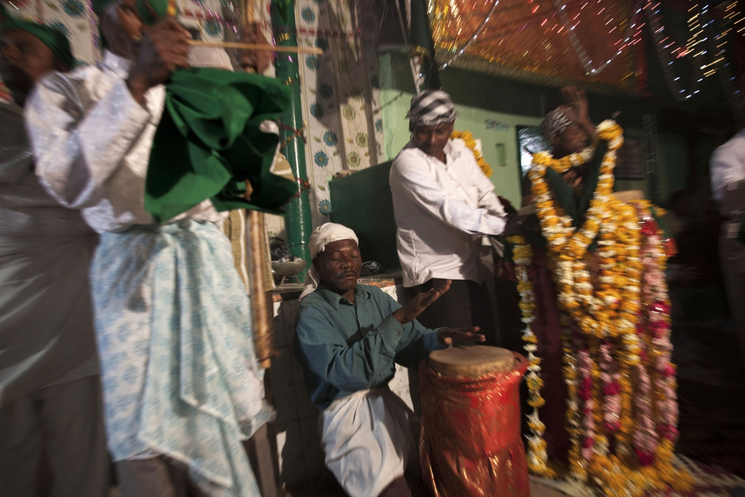 During the annual celebration of Urs, the anniversary of their saint Bava Gor, the Sidi play music, sing and dance all night until morning. Bedi, India