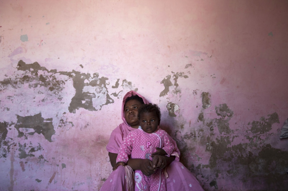 A Sheedi women sits with her child at her house in a Sheedi suburb of Hyderabad. Hyderabad, Pakistan