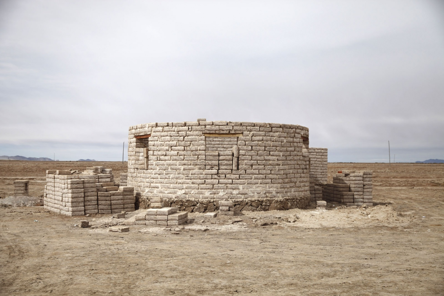 A house structure made solely of salt bricks on the edge of the Salar de Uyuni. The salt bricks are cheaper and easier to repair than regular concrete bricks. Bolivia.