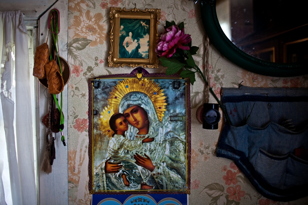 Madonna and the Christ child hang on the wall, at the home of Ungelfug Gennadiy Rihardovich, 61 years old, in Korotkeros. Ungelfug and his father are from Povolgie, they were exiled in 1930 due to the dispossession of the Kulaks.