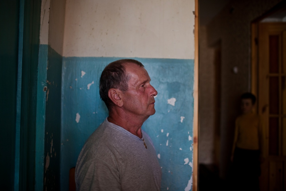 Ungelfug Gennadiy Rihardovich, 61, years old, and his grandson, fourth generation Russian German, Dima Dmitry, 8 years old, in the hallway of their home in Korotkeros, a small town outside of Syktyvkar, Russia.