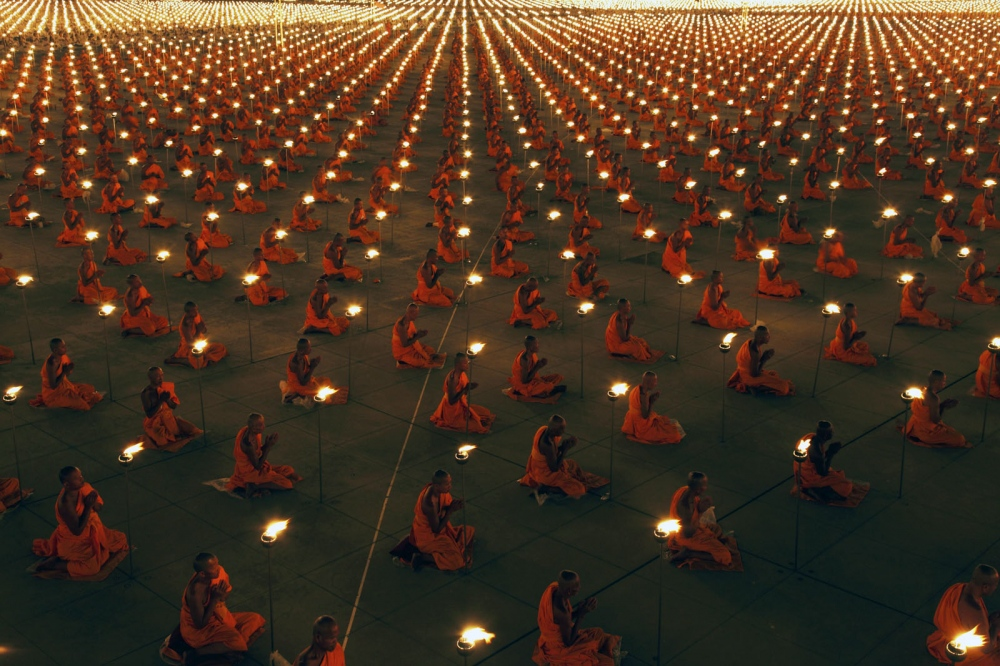 40,000 monks pray during the celebrations of Makha Bucha, a Buddhist holy day, at the Dhammakaya Temple. Bangkok, Thailand