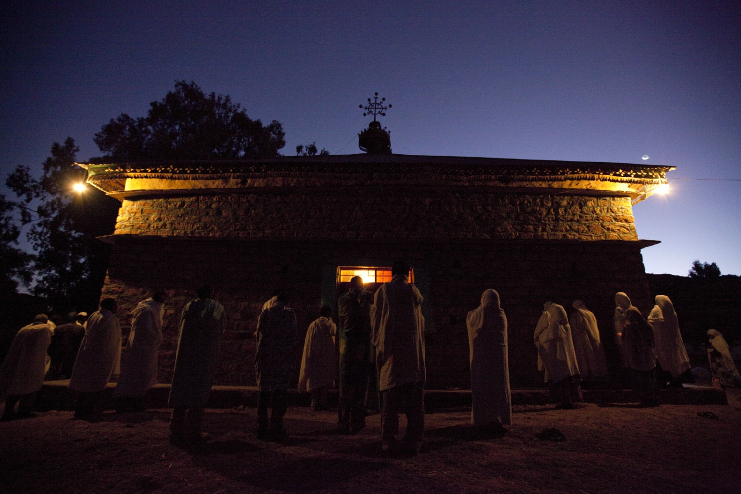 Ethiopian Orthodox Chirtsians gather at an ancient church in Hawzen during a religious festival. Tigray, Ethiopia.