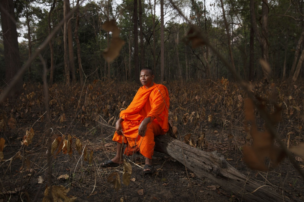 Eco-warrior Buddhist monk Bun Saluth in the forest he saved from loggers and encroachment. Oddar Meanchey, Cambodia