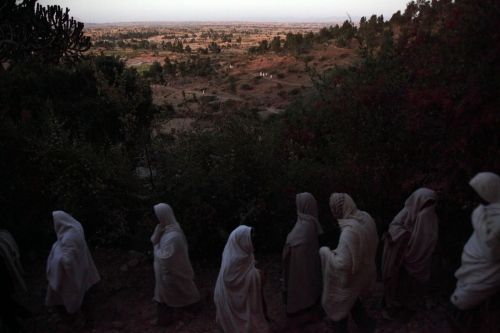 Ethiopian Orthodox Chirtsians arrive at dawn for a religious ceremony. Wukro, Tigray, Ethiopia.