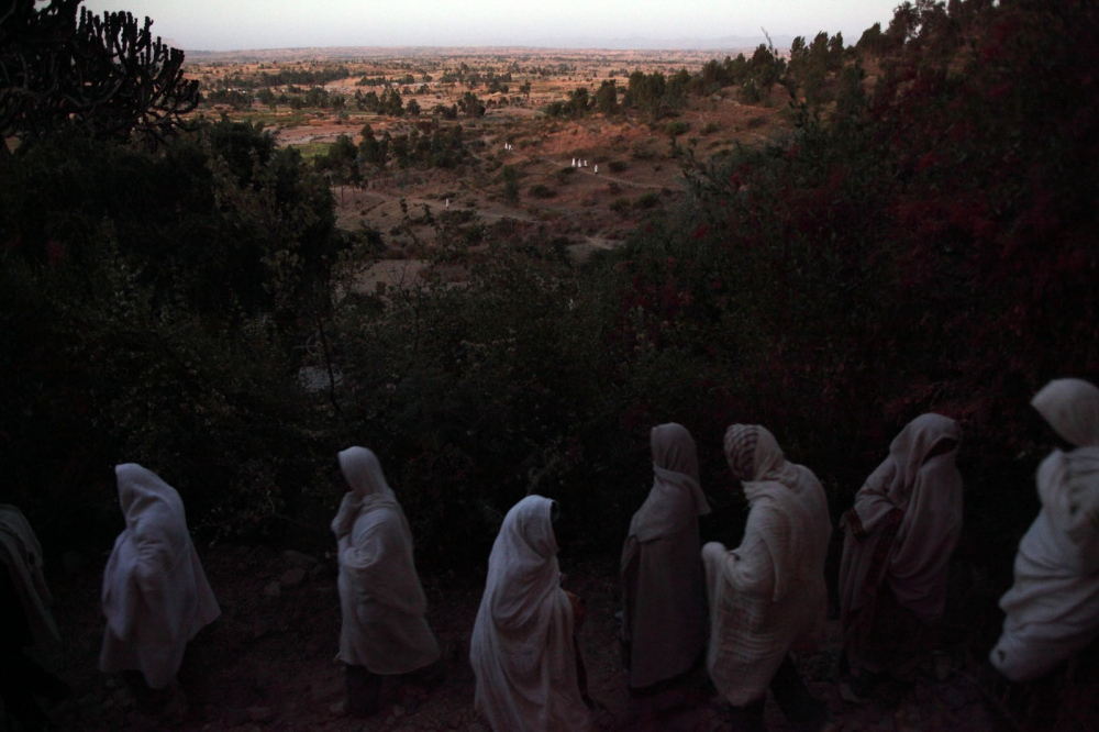 Ethiopian Orthodox Chirtsians arrive at dawn for a religious ceremony. Wukro, Tigray, Ethiopia.