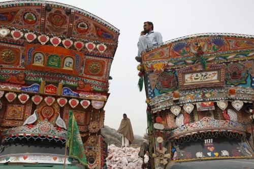 Trucks ready to transport the pink rock salt at the Warcha salt mine in Pakistan.