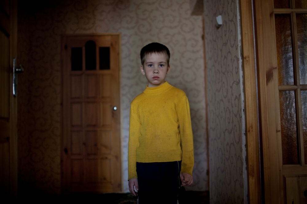 Fourth generation Russian German, Dima Dmitry, 8 years old, stands for a portrait at his home in Korotkeros, outside of Syktyvkar Russia.