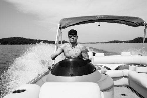 Lake Ozark, Missouri, Usa, 2016. Todd Nicely, driving his boat.