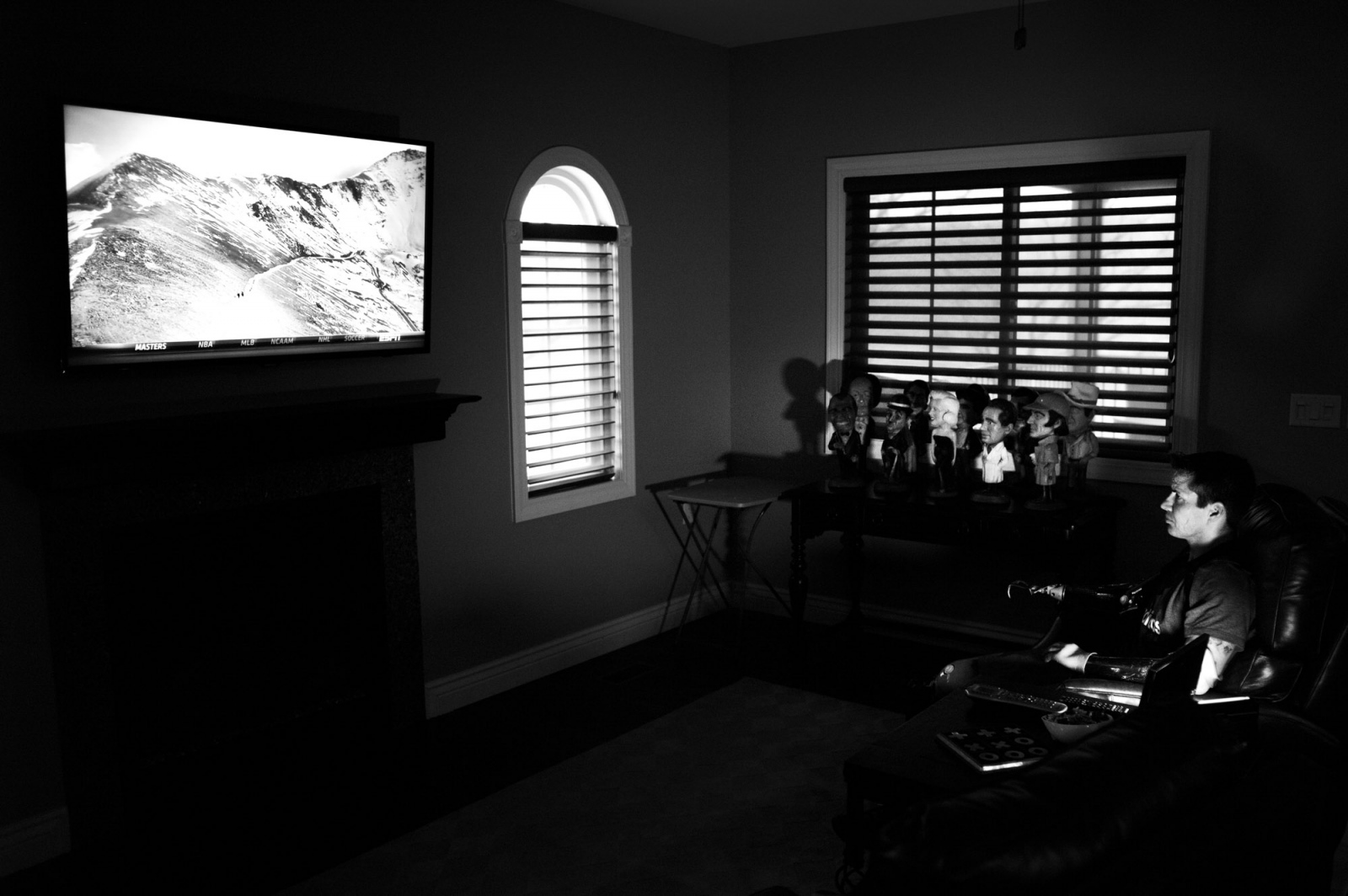 Lake Ozark, Missouri, USA. 2014. Todd Nicely watching a documentary on the TV in his living room.