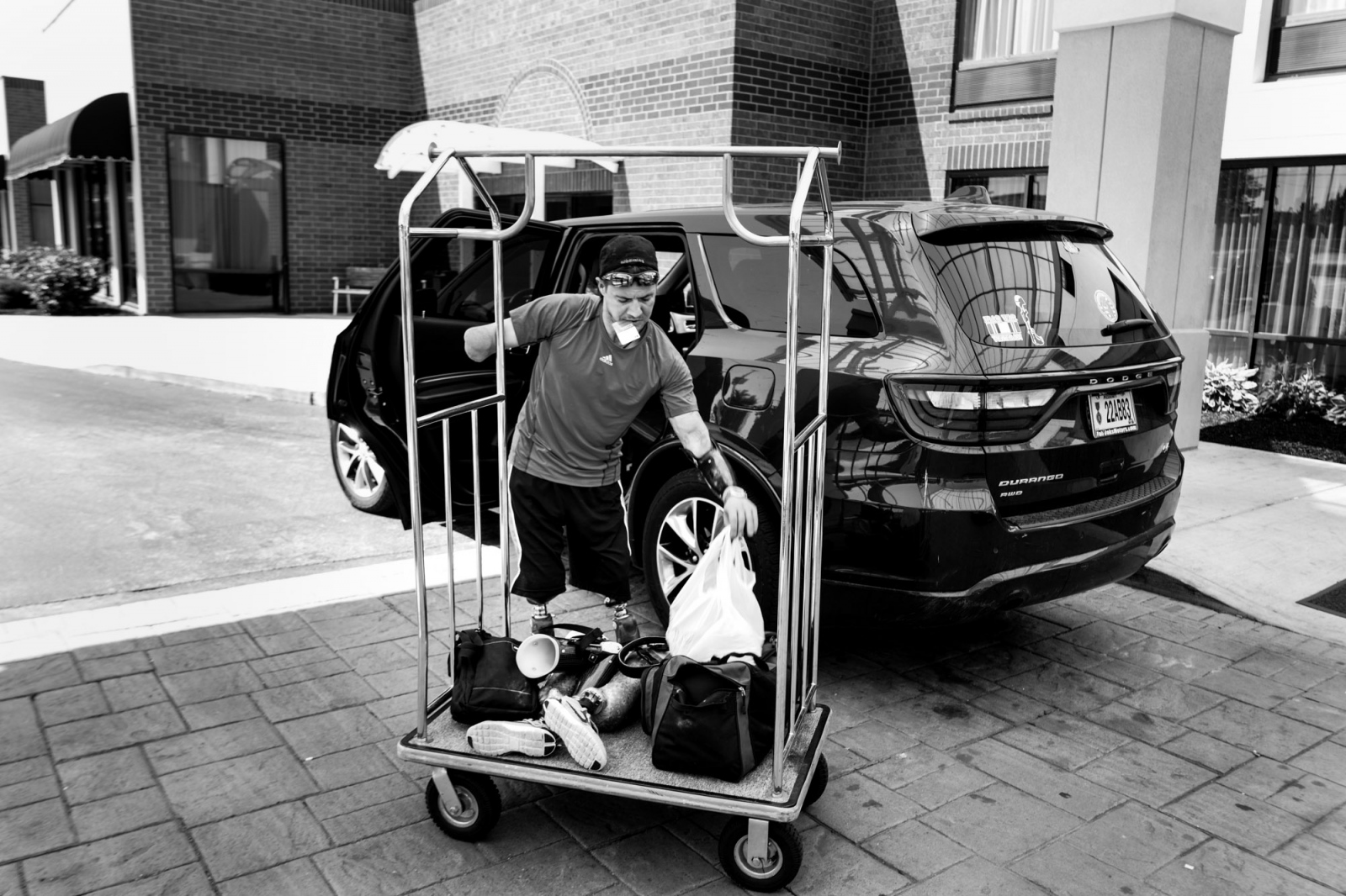 St. Louis, Missouri, USA, 2016. Todd Nicely, retrieving his luggages and his prosthesis from his car.
