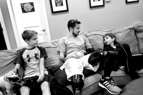 St. Louis, Missouri, USA. 2015. Todd Nicely and his nephews spending time together playing with the Xbox at his sister Nikky's home.