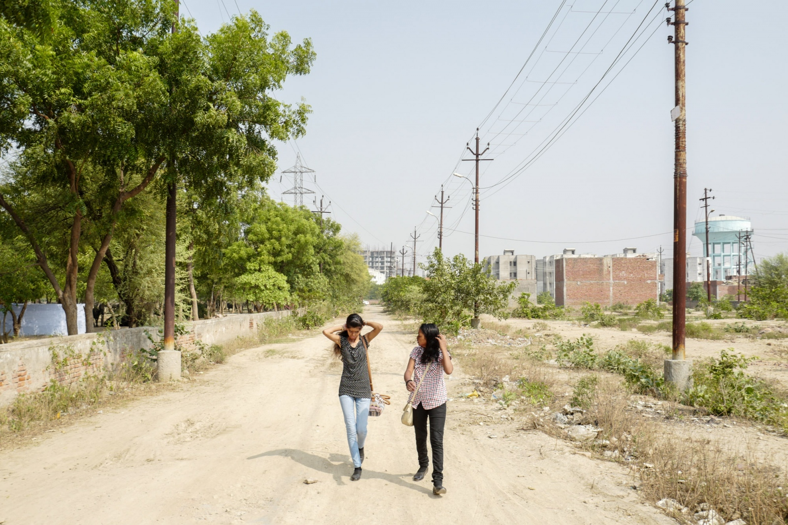 Agra, Uttar Pradesh, 03 November 2015, Ritu and Rupa, are going to work in the middle of the street behind their house in Agra.