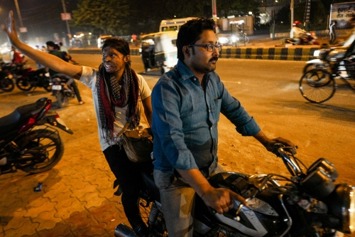 Agra, Uttar Pradesh, 27 October 2015. Rupa is sitting on a motorcycle with a volounteer of the Stop Acid Attack.