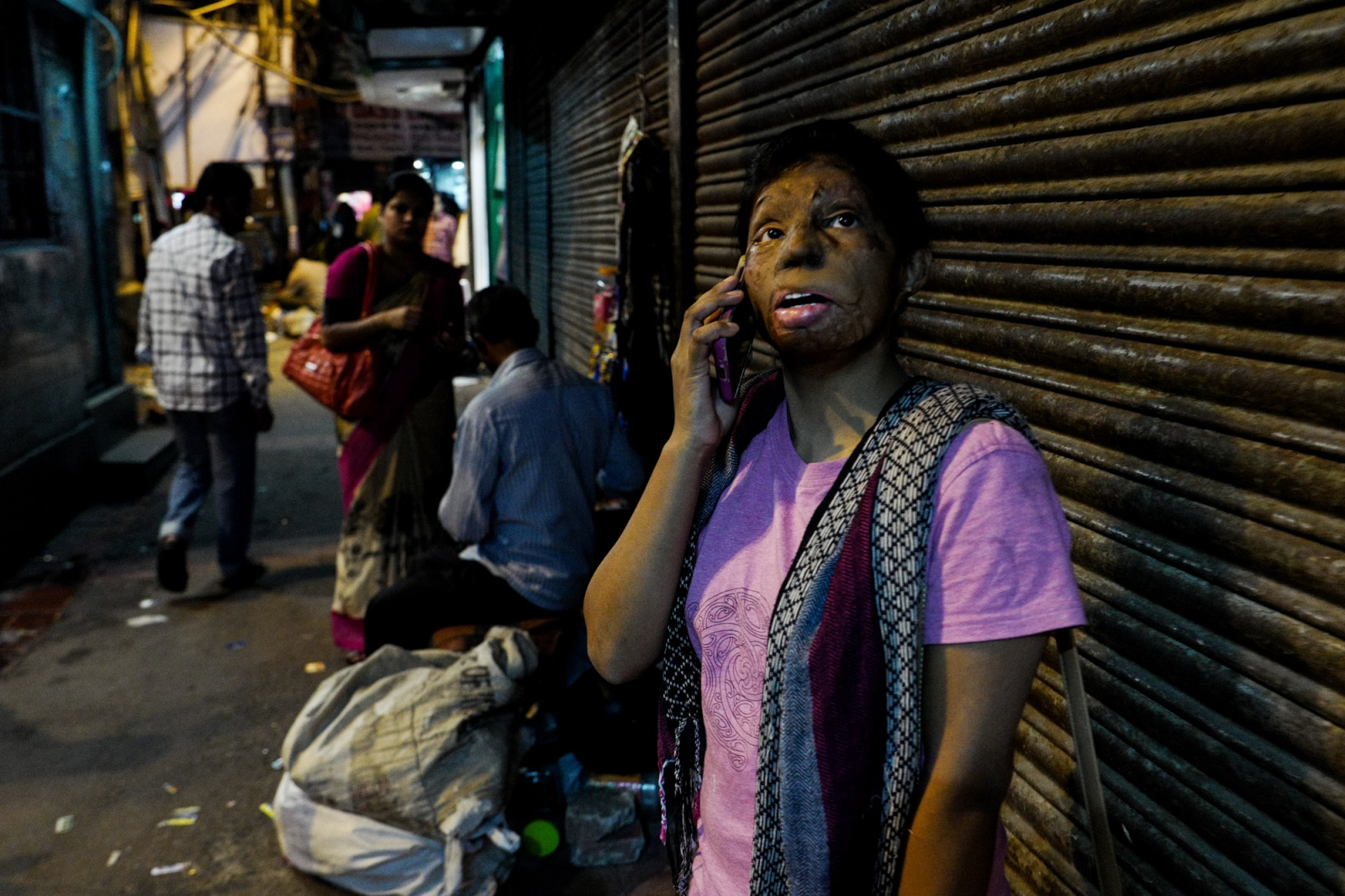 Delhi, 26 October 2015, Rupa talking at phone in chandni chowk market, famous for its fabrics.