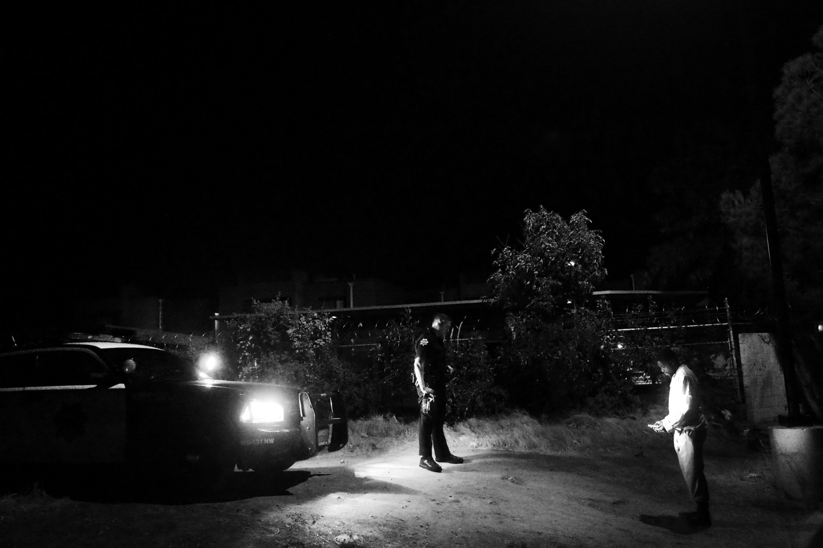 Fresno, California, 2013 A police officer from the northern district of the city has stopped a suspect to interrogate him in a notorious neighborhood.