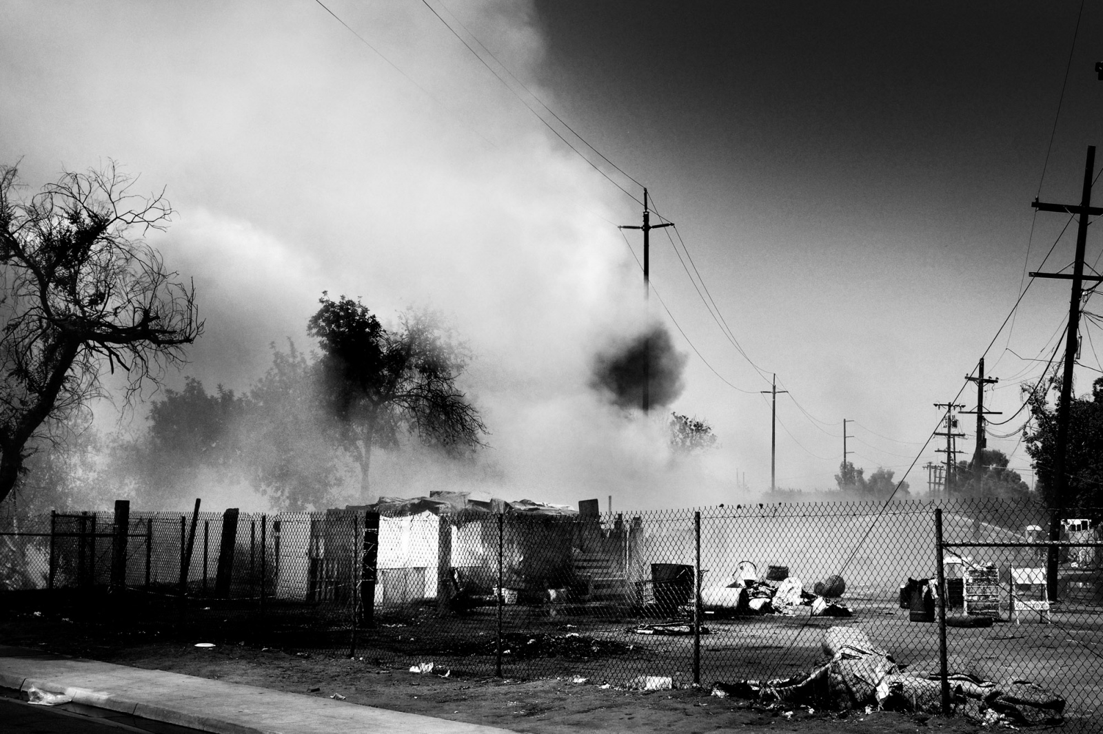 Fresno, California, 2013 A fire breaks out in a homeless camp in the West Fresno district. Fires are common and they are start for different reasons, one of the main causes is the production of Metanfetamine when people make it at home because during the process some of the components are extremely inflammable.