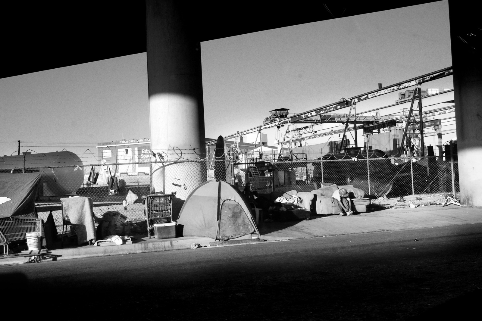 Fresno, California, 2013 In a part of downtown Fresno, the Old city, for years it has been populated by a shanty town of tents and where homeless sleep rough living on the edge of the highway, they crowd around the bridge pilons, any commercial activites have abandoned this area to move to the northern part of the city.