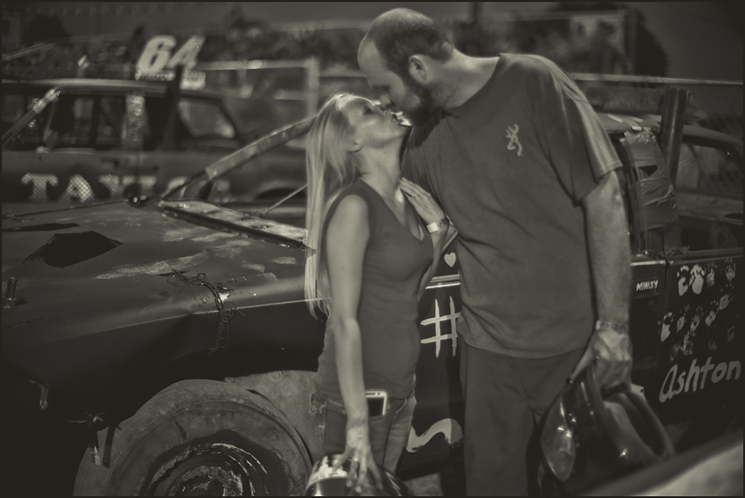 Atlas and Alissa Barber kissing one another prior to competiting in Demolition Derby against each other. Wilson County Fair, Lebanon, TN.  September 2016.