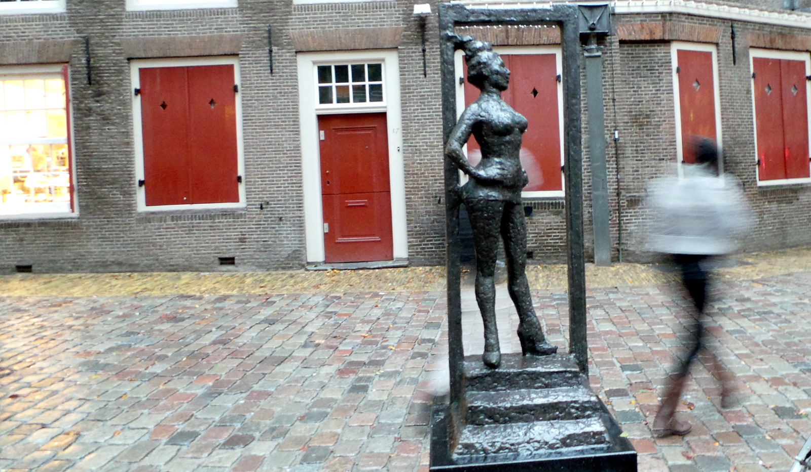 Titled Belle , the statue depicts a full-breasted woman who, feet apart and standing in a doorway at the top of a small set of steps, looks self-assuredly into the world. The statue is meant to show respect to the millions of people around the world who earn their money in prostitution.