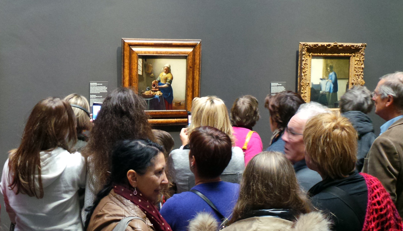 Crowds jostle for a look at Vermeer's The Milkmaid at the Rijksmuseum.