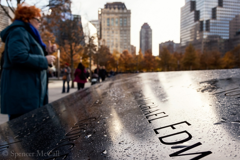 Photography image - Loading A_Woman_At_The_911_Memorial_Wall_2014SpencerMcCall.jpg