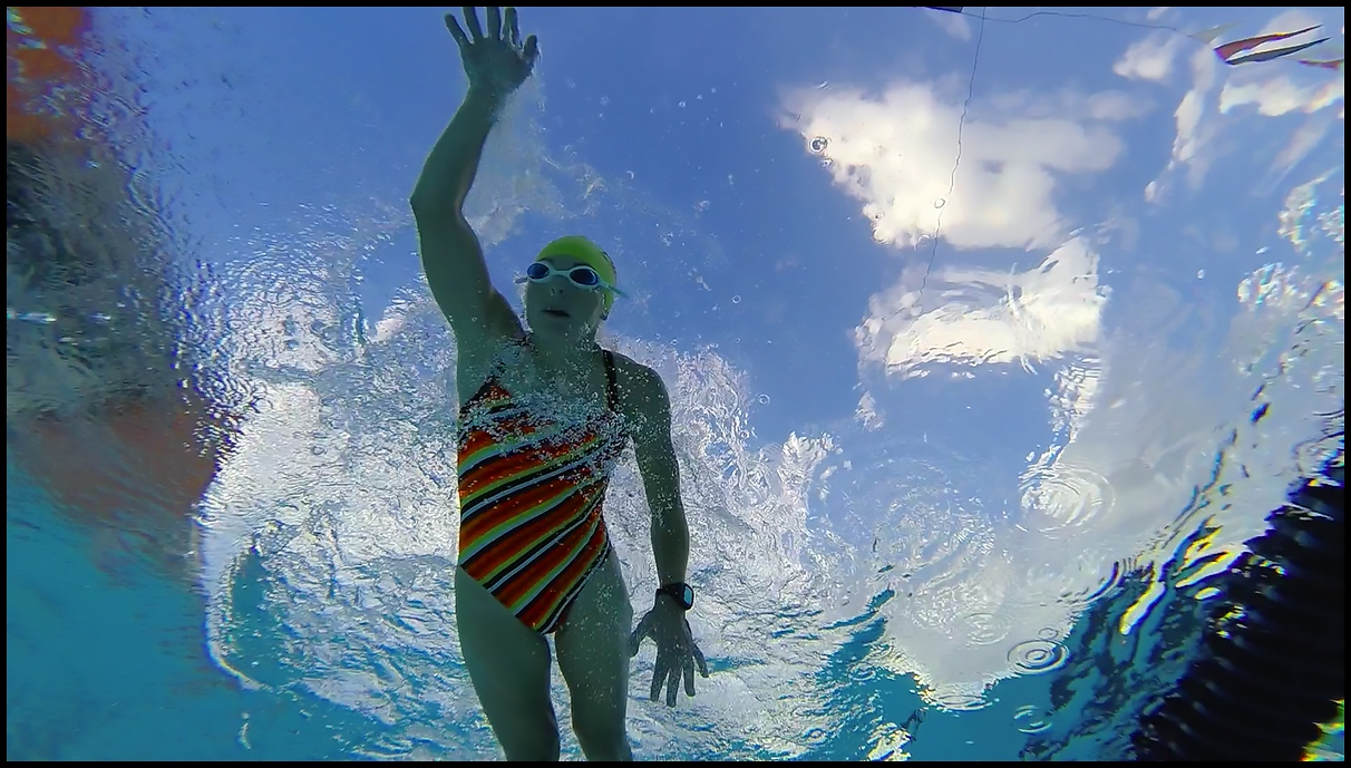 Three images from cinema project on Ironman Triathlete Lisa Roberts, training and competiting at Ironman World Championships, Kona, Hawai'i, HI. 2014