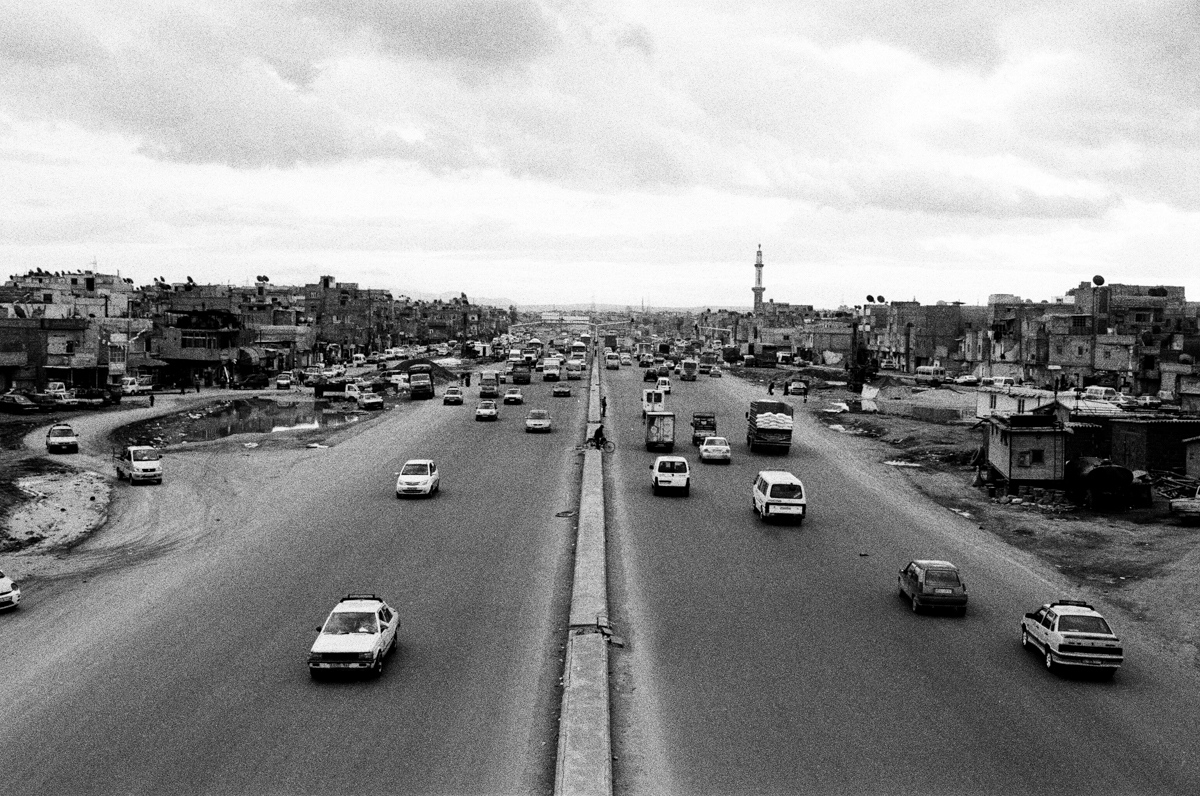 "The southern highway, named after Hafez Assad, defines the border between Damascus and the countryside. Slums however are on bothsides, before there was a highway here, there were homes of ""collective violation"". Damascus, 2010"