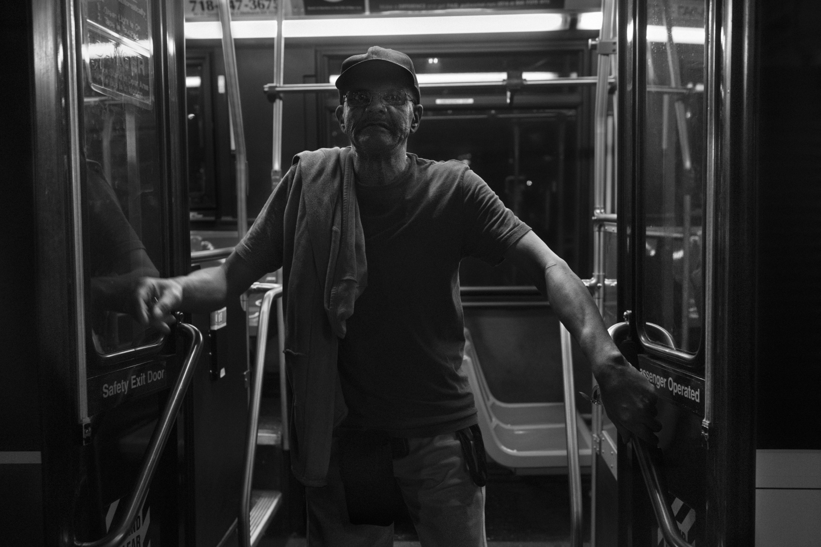 Alvin Jeffires, 65, gets off the Q100 bus on the night of his release from Rikers Island after trying to recover his property. A Vietnam veteran, Alvin retired in New York after the war and lived from his army pension until one day he was wrongfully arrested after being mistakenly arrested by the NYPD. August 18th, 2016.