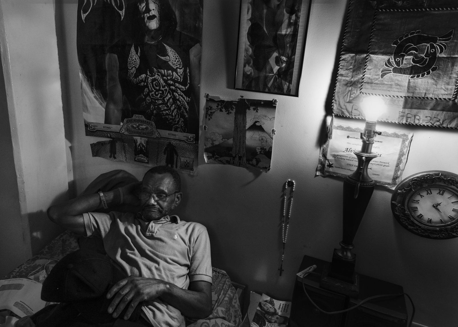 """Alvin watches TV at his apartment in Downtown Brooklyn days after being released from Rikers Island. All the charges were dropped when CCTV footage demonstrated Alvin was Innocent. He is currently in the process of suing the city for wrongful arrest and false imprisonment. Alvin said, """"I never bothered nobody in my life, I don't look for trouble, I'm not violent, only in the war because I had to... not even a transit ticket, clean"""". August 18th, 2016August 25th, 2016"""