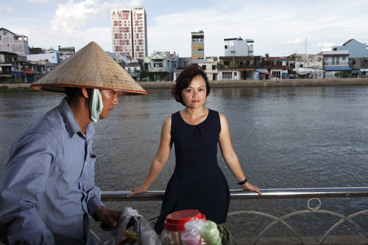 Hong Hoang of Vietnam's office of 350.org is photographed by a river in Ho Chi Minh City.