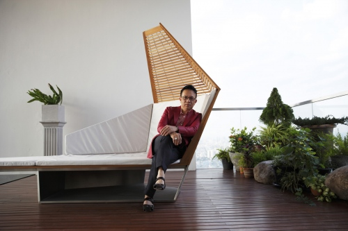 Panint Jhonlerkieat sits on the top floor of his penthouse condominium at The Pano in Bangkok. A self-made millionaire who is the Managing Director and Co-founder of Aim Star Network bought his triplex home for a massive $3.75 million. Bangkok, Thailand.