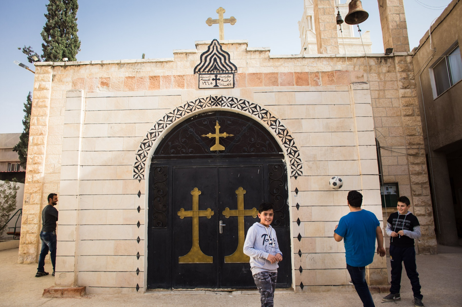 Jordanian Christian youth play outside the Orthodox church in Mafraq, near the Syrian border. The town has boomed from rougly 70,000 original inhabitants to nearly half a million, with Zaatari refugee camp and the Syrian refugees living throughout the town. In summer 2016, Father Dimitrius Samawi decided to start educational programs for kids - including language, science and math - for Syrian children to attend. A mix of Muslim and Christian children attend the program, and the church also offers Bible study groups for the Christians who come.
