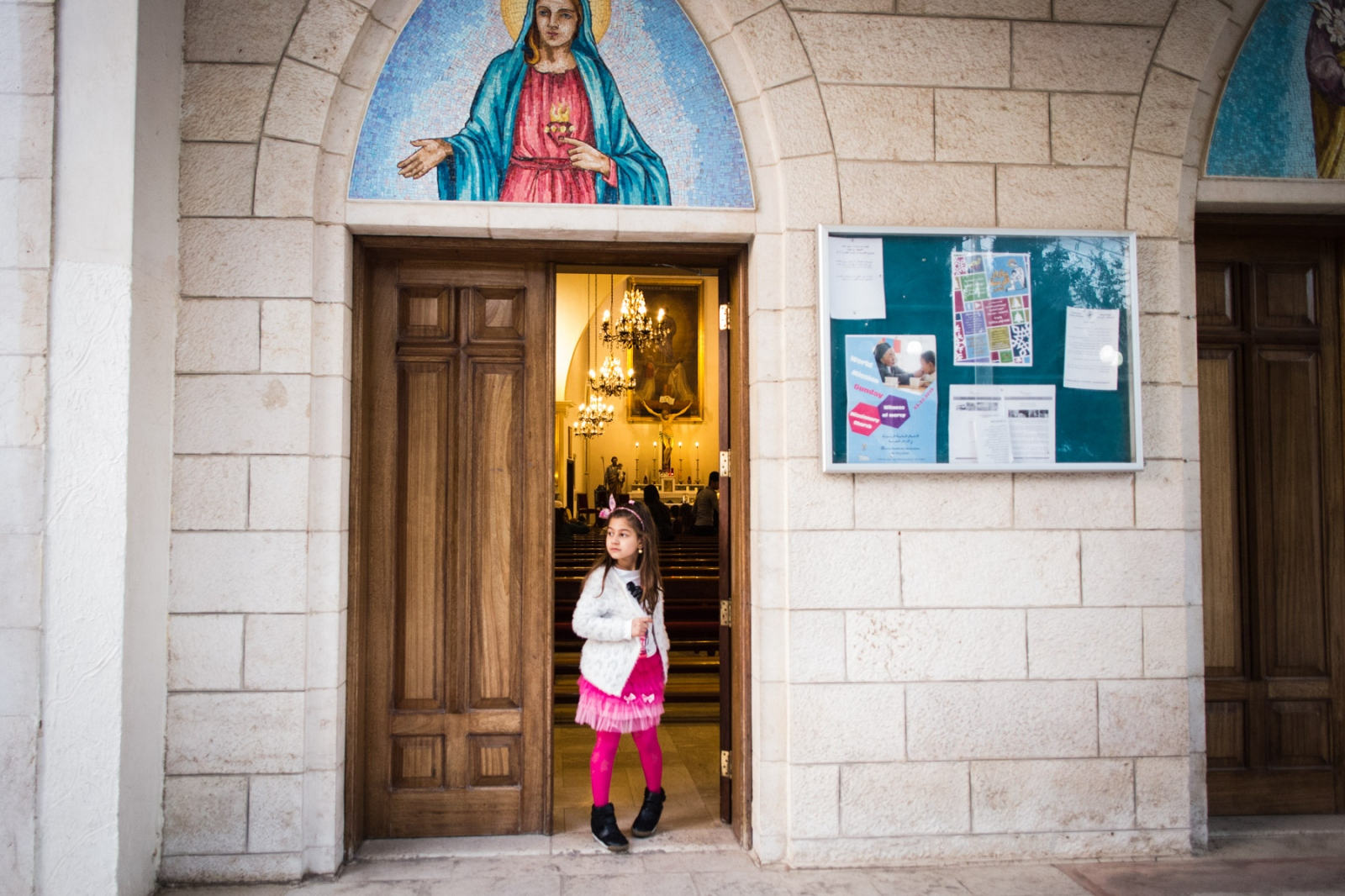 Faustina, 4, stands in the doorway of the Mar Youssef church in Amman, Jordan, on Nov. 4, 2016. She has lived in Amman with her family since fleeing Mosul over a year ago when ISIS took over.